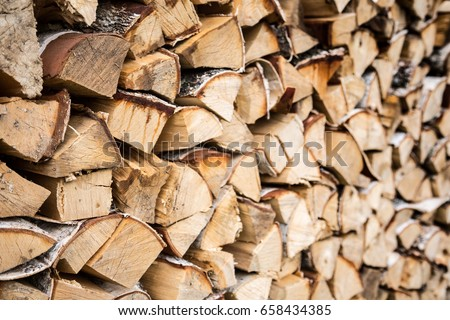 pile firewood prepared for fireplace kilndried firewood background