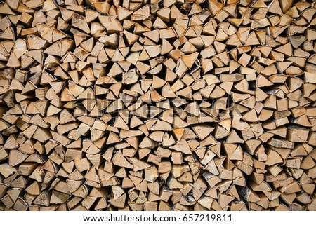 pile firewood prepared for fireplace kilndried firewood background wall of dry chopped