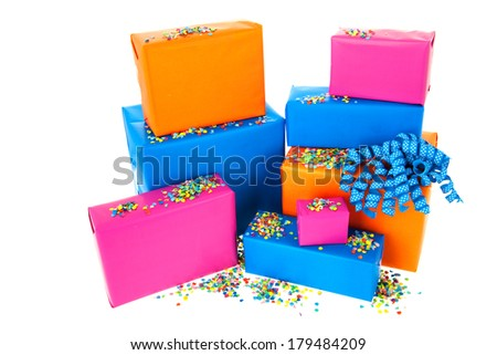 Pile gifts in many colors with confetti isolated over white background - stock photo