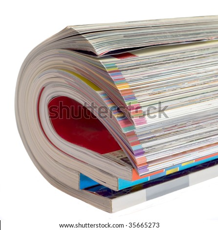 Pile glossy magazines is curtailed into roll isolated on white background