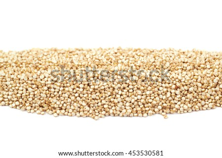 Pile line of grain quinoa seeds isolated over the white background - stock photo