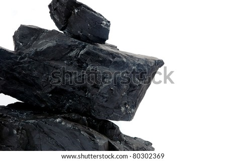 pile lumps of coals isoated on white background - stock photo