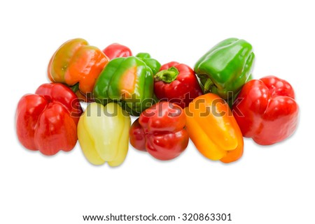 Pile of a fresh bell peppers various shapes and colors on a light background. Isolation.