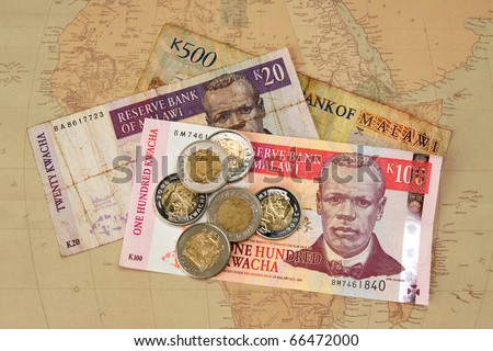 Pile of African currency on map - stock photo