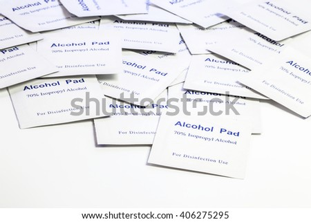Pile of alcohol pads for disinfection use packed on white background