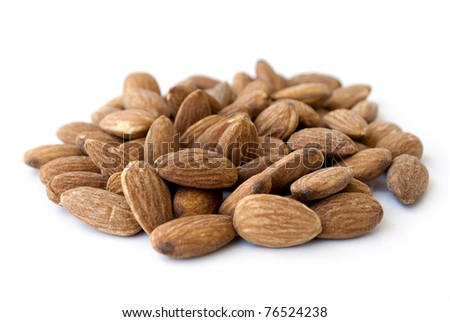 pile of almond nuts isolated on white - stock photo