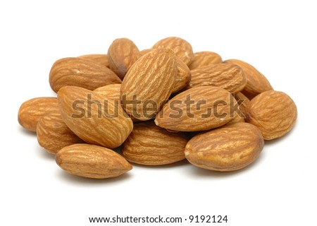 Pile of almonds in isolated white background - stock photo