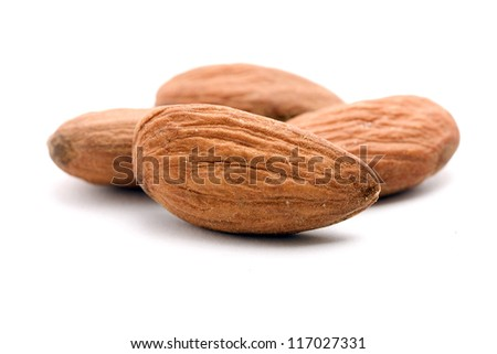 pile of almonds on white - stock photo