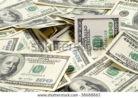 Pile of american dollars arranged as background