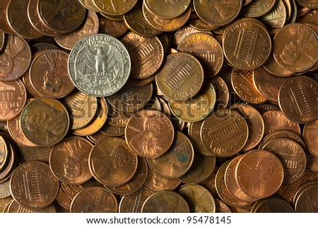 Pile of American pennies and a quarter of a dollar. - stock photo