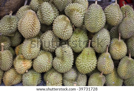 Pile of Asian Durian fruit for sale at roadside stall in Saigon, Vietnam