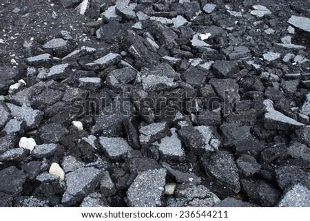 Pile of asphalt road surface - stock photo