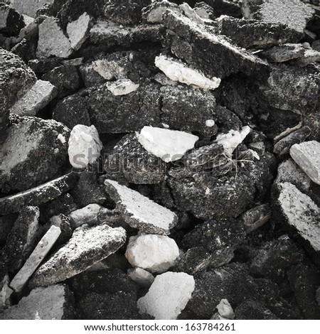 Pile of asphalt rubble - stock photo