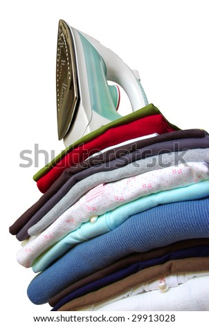 Pile of assorted clothes and iron isolated in white background - stock photo