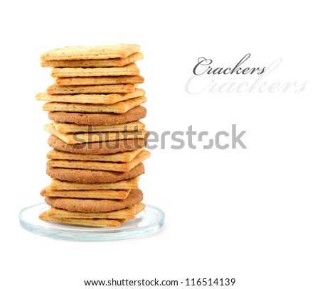 Pile of assorted crackers on a small glass plate,  isolated on white with copy space.