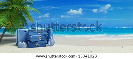 Pile of baggage on a tropical beach - stock photo