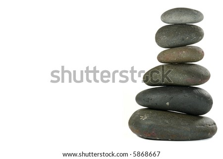 Pile of Balanced Stones in Zen-like Setting Representing Meditation. Isolated on White. - stock photo