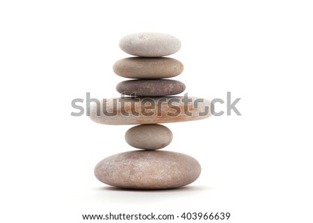 Pile of balancing pebble stones, like ZEN stone, isolated on white background, spa tranquil scene concept - stock photo