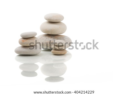 Pile of balancing pebble stones, like ZEN stone, isolated on white background, spa tranquil scene concept with reflection - stock photo