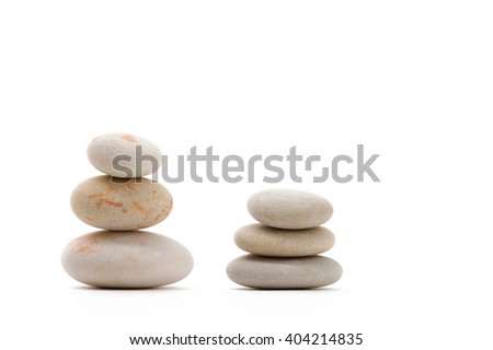 Pile of balancing pebble stones, like ZEN stone, isolated on white background, spa tranquil scene concept
