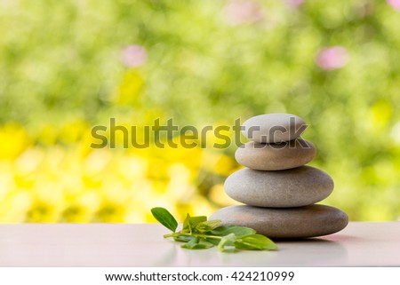 Pile of balancing pebble stones, like ZEN stone, outdoor in spring, spa wellness tranquil scene, soul equanimity concept, mental calmness