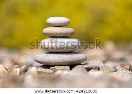 Pile of balancing pebble stones, like ZEN stone, outdoor in spring, spa wellness tranquil scene, soul equanimity concept, mental calmness - stock photo