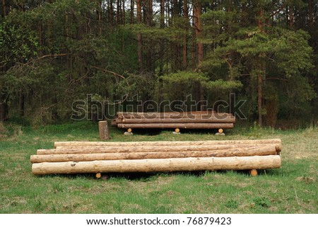 pile of balk near forest - stock photo
