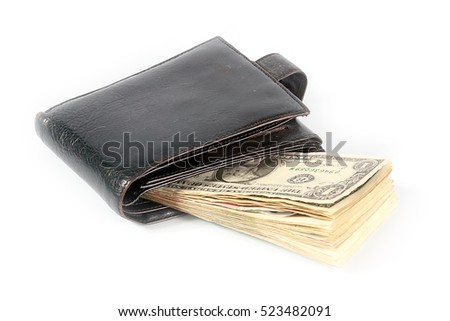 pile of banknotes dollars in leather purse