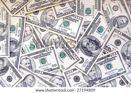 Pile of banknotes of fifty and hundred dollars - stock photo