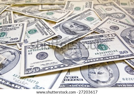 Pile of banknotes of fifty and hundred dollars. - stock photo