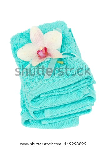 pile of bath towels with orchid flower isolated on white background - stock photo