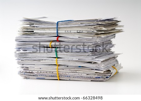 Pile of bills tied together - stock photo