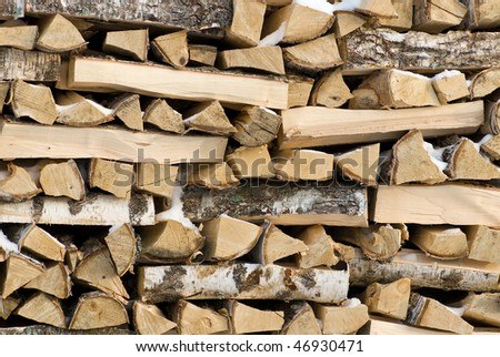 Pile of birch firewood - stock photo