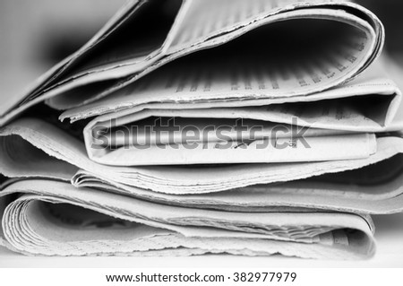 Pile of  black and white newspapers - stock photo