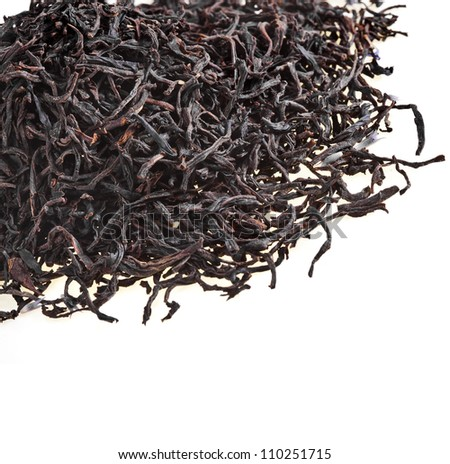 Pile of black Earl Gray tea isolated on white - stock photo
