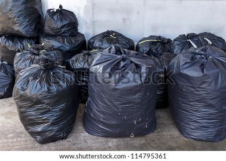 pile of black garbage bags - stock photo
