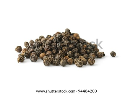 Pile of black whole pepper isolated on white background - stock photo