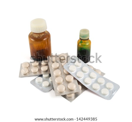 Pile of blister bubble pack of pills and two medical vials composition isolated over white background