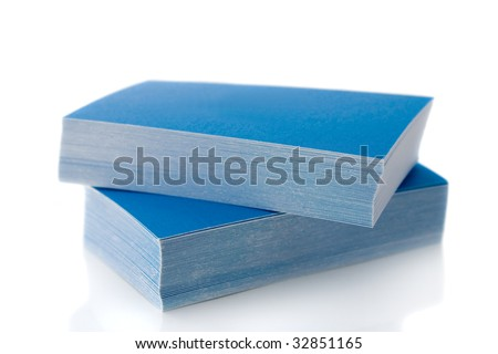 Pile of blue business cards, isolated on white background, with shadow - stock photo