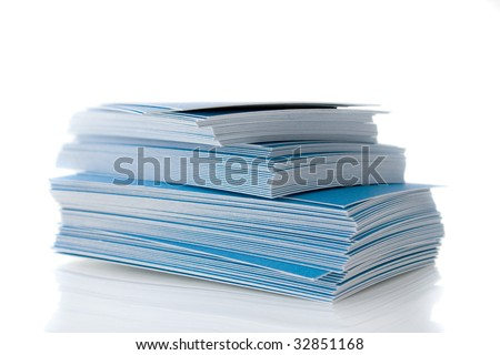 Pile of blue business cards, isolated on white background, with shadow