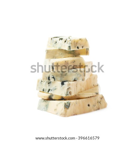 Pile of blue cheese slices isolated - stock photo