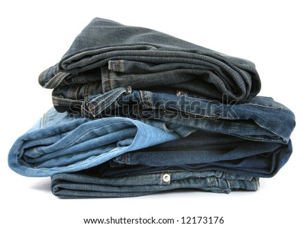 pile of blue jeans isolated on white background - stock photo