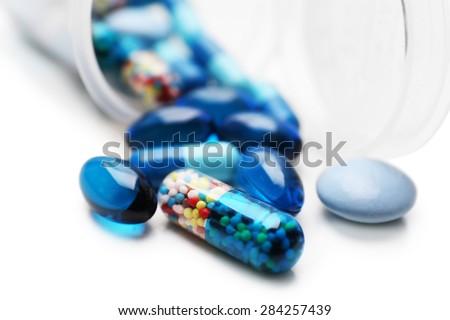 Pile of blue pills, closeup - stock photo