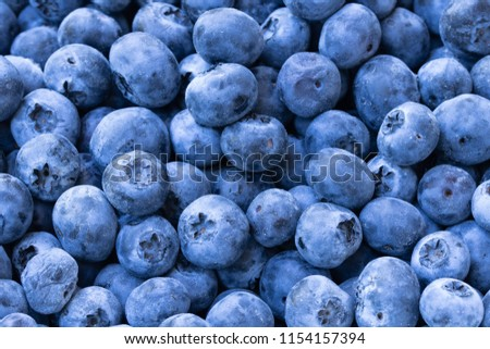 stock-photo-pile-of-blueberries-up-close