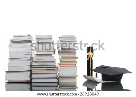 Pile of books and graduation things.