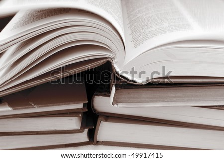 pile of books in black and white  color - stock photo