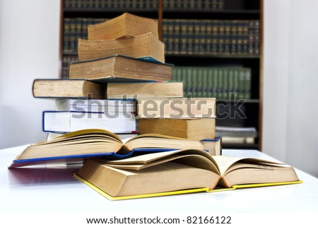 Pile of books in library with clipping path - stock photo