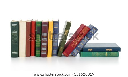 Pile of books isolated on white background. - stock photo