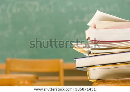 Pile of books on a desk - stock photo