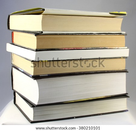 pile of books on a gray background
